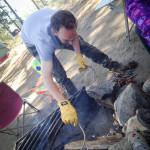 Darren tends to the fire.